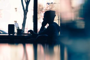 reader in coffeshop